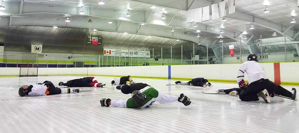 players stretching on the ice