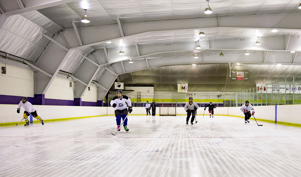 players skating up the ice