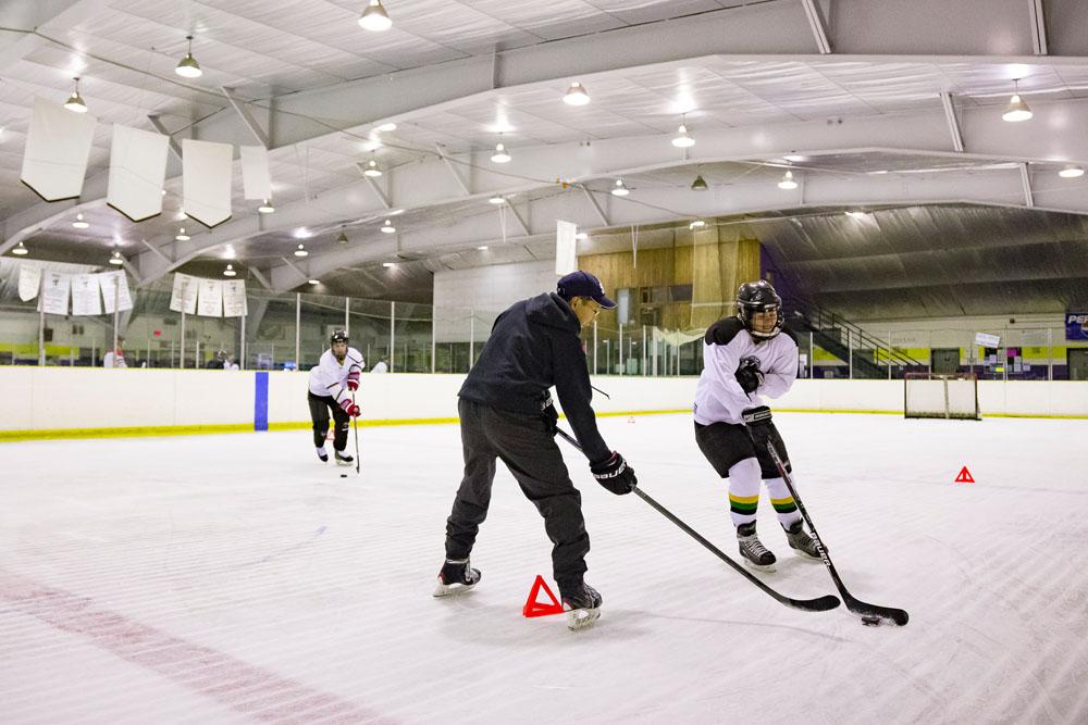 player skating around cone & Rob